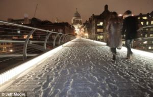 London's Millennium Bridge coated in snow