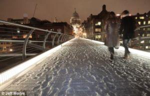 London's Millennium Bridge coated in snow