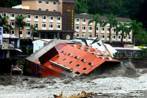 A hotel collapses into a raging river in Taiwan