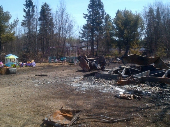 Charred remains of a mobile home on Middlesex Road, NB, 08 May 2013 (Dearing)