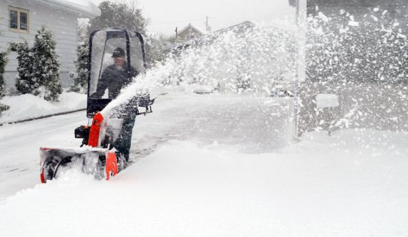 Man uses a snowblower in Timmins, ON, 12 May 2013 (Timmins Press)