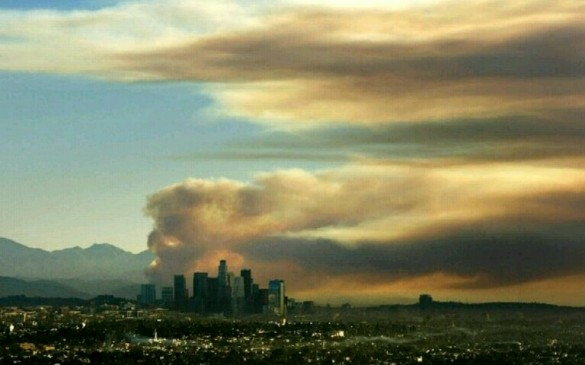Smoke from a wildfire behind the Los Angeles skyline, 16 Jan 2014 (LA Times)