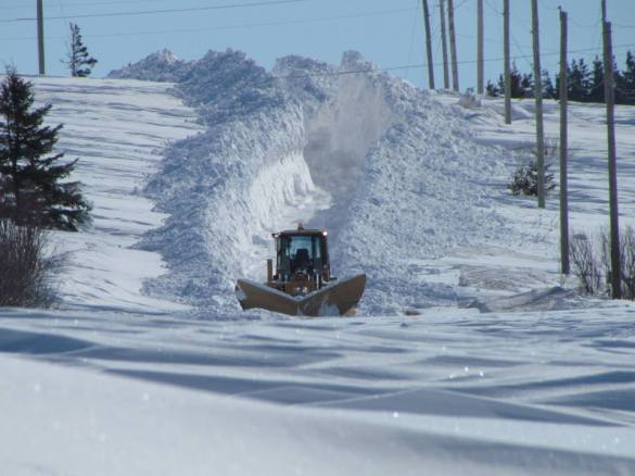 A plow makes its way through heavy snow on Route 20 near Park Corner, PEI, 16 March 2015 (Facebook)