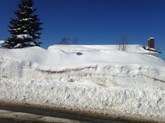 Typical home hidden by huge snowbanks in NW Moncton, 28 Feb 2015 (Clow)