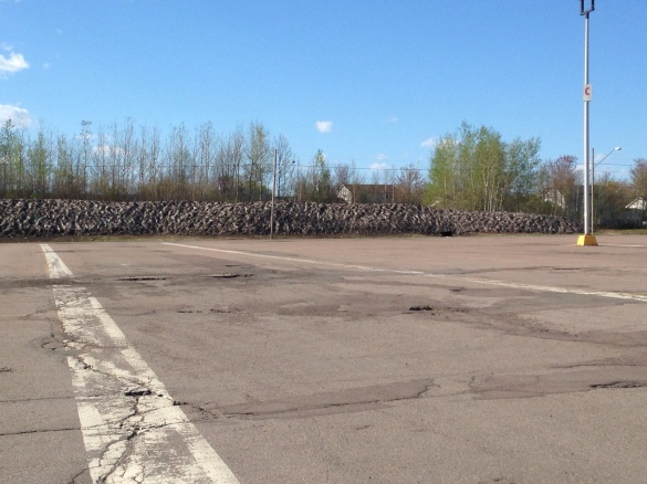 A huge, dirty pile of snow at Moncton Coliseum, 21 May 2015 (Dearing)