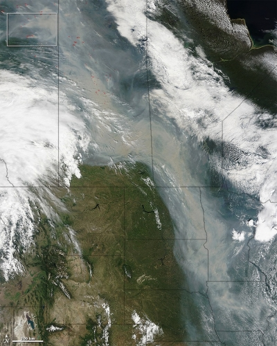 Smoke from forest fires in Western Canada drifts south deep into the USA, 29 June 2015 (NASA)