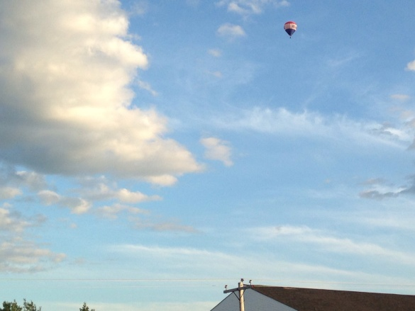 A realty firm sponsored hot air balloon floats over NE Moncton, 10 August 2015 (Dearing)